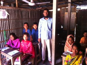 A teacher and students at Grambangla School