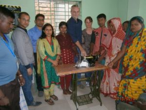 Social workers and I with members of the Wastepickers Cooporative presenting the young man with his sewing machine