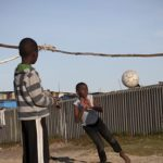Children play by Khayelitsha township near Cape Town