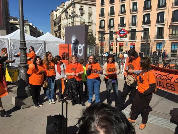 Social workers standing in a circle in Spain for World Social Work Day 2017