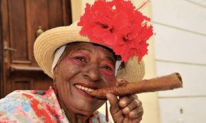 Woman in a hat posing with a cigar